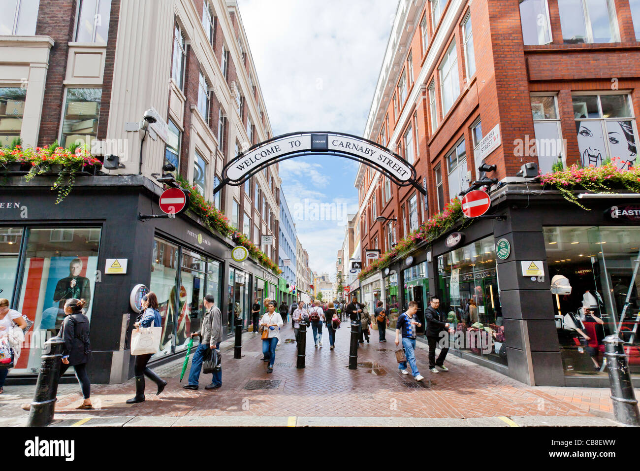 People, Shoppers, Pedestrians on Carnaby Street, London, England. Stock Photo