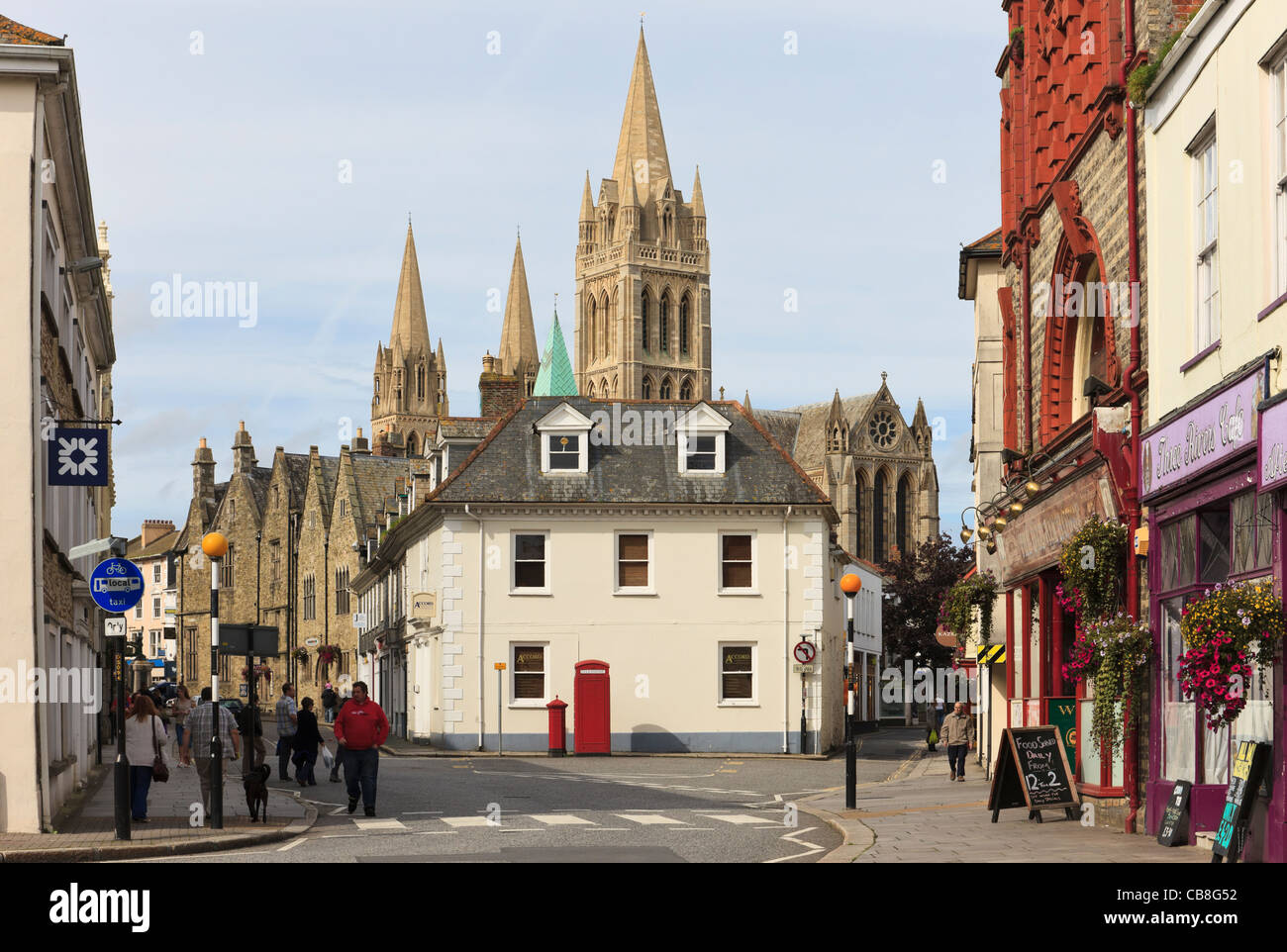 Street scene and view to Truro cathedral with three spires. Quay Street, Truro, Cornwall, England, UK, Britain. - Stock Image