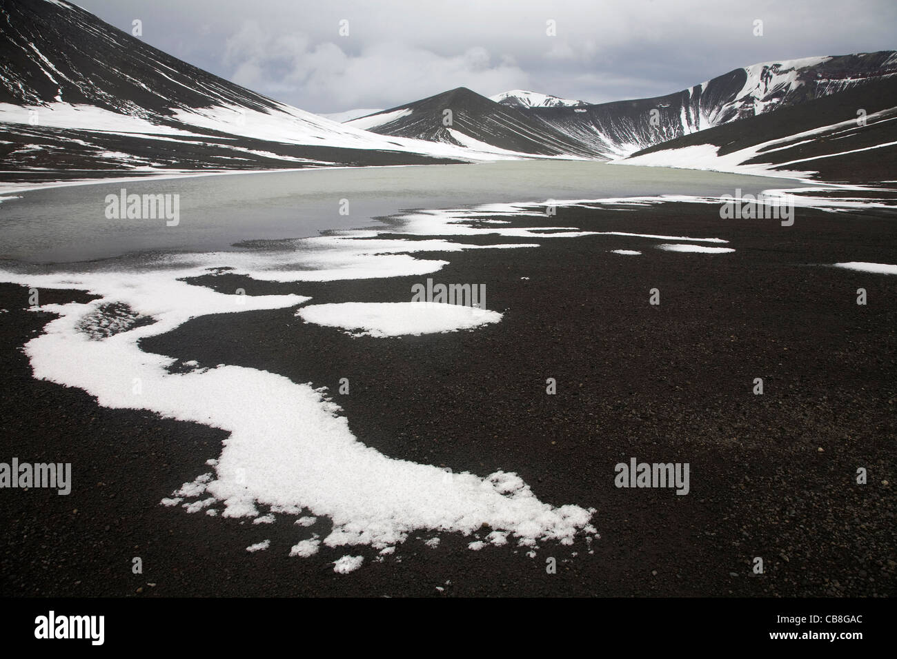Mountains and lake in caldera of active volcano on Deception Island, South Shetland Islands, Antarctica - Stock Image