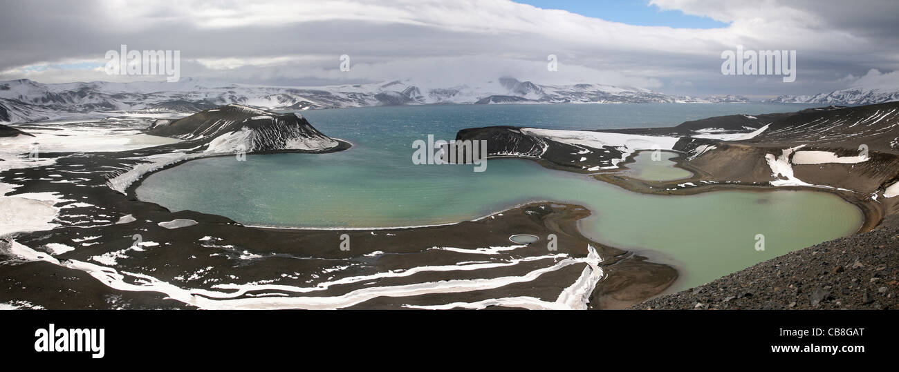 Aerial view over Antarctic sea and craters on Telefon Bay on Deception Island, South Shetland Islands, Antarctica - Stock Image