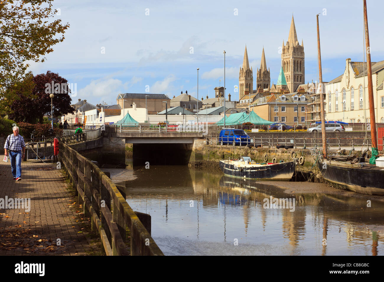 Riverside walk with view across River Truro towards the city and three spires of the Cathedral. Truro, Cornwall, - Stock Image