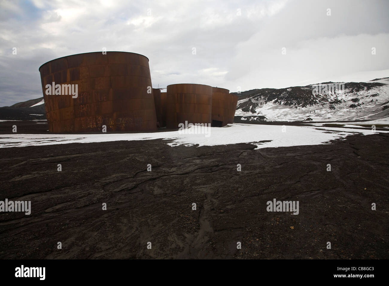 Rusty tanks at old whaling station at Whaler's Bay, Deception Island, South Shetland Islands, Antarctica - Stock Image