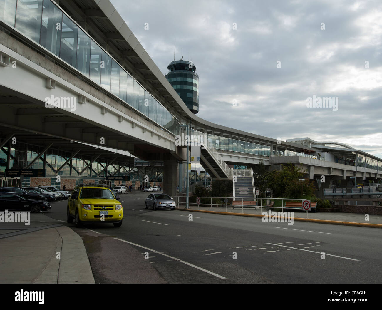 Taxicab outside Vancouver Airport at the Departures Level, Vancouver, British Columbia, Canada - Stock Image