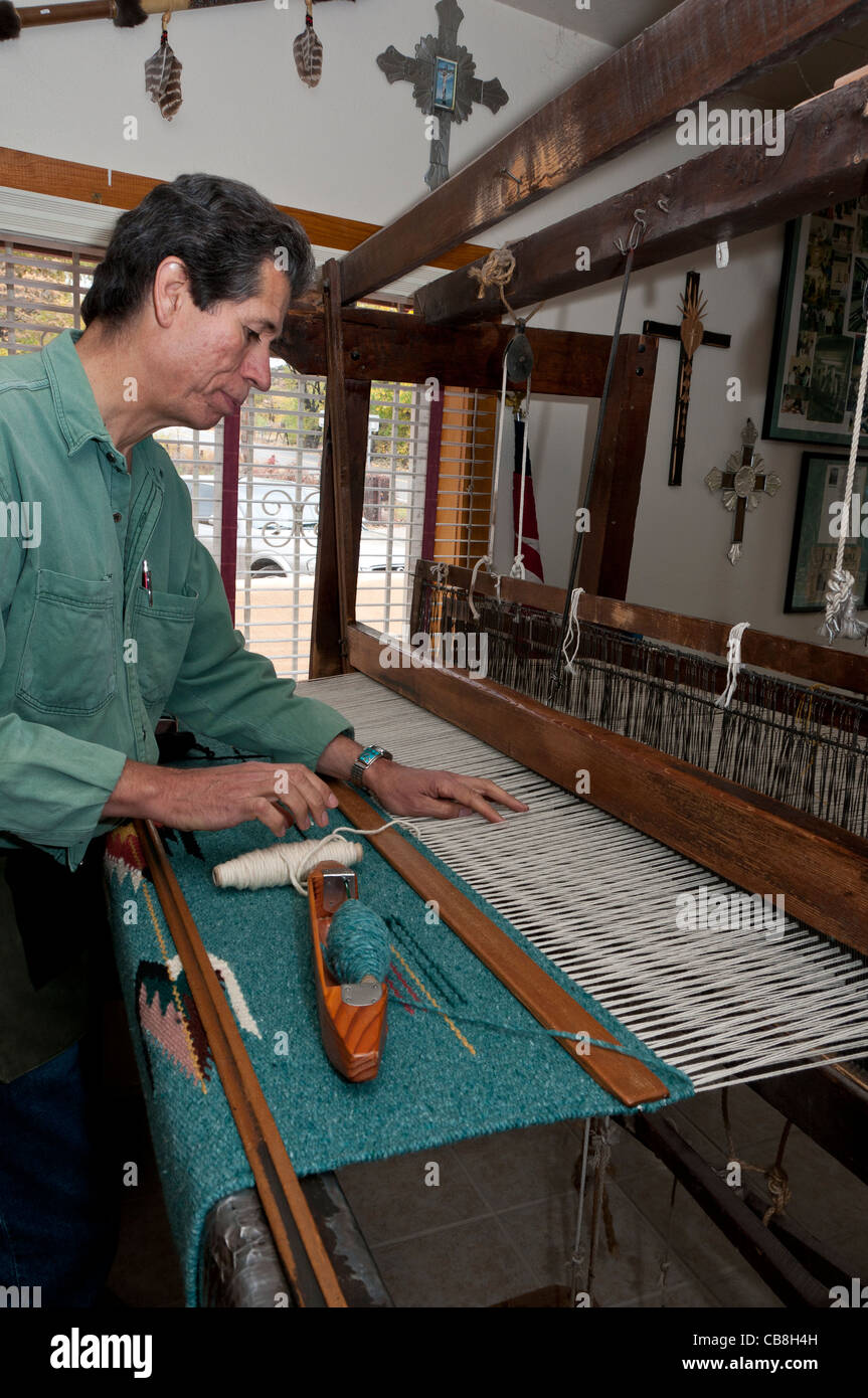Weaver at work, Trujillo's Weaving Shop, Chimayo, New Mexico. Stock Photo