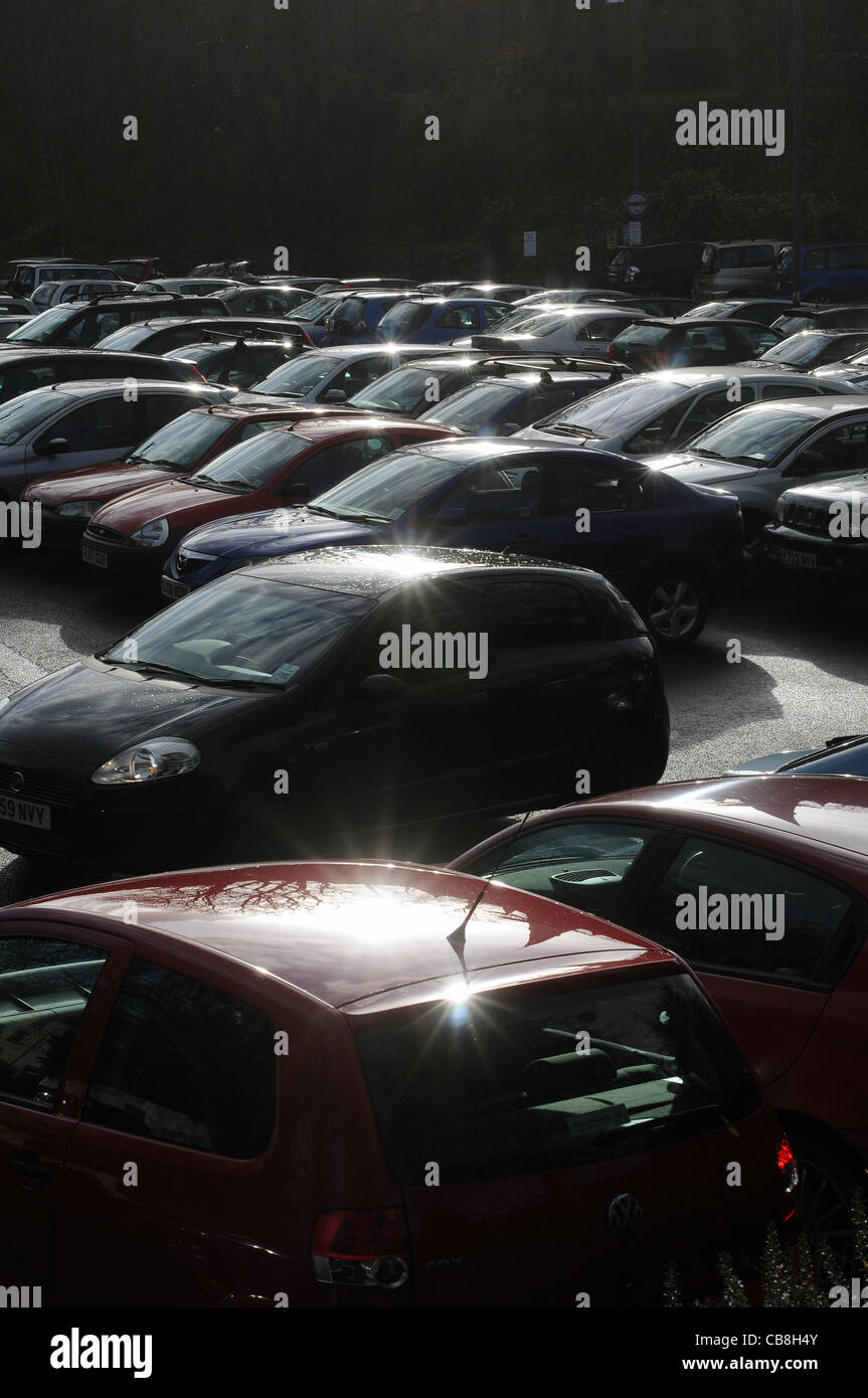 Backlit cars in car park,Keywords: abstract, auto, automobiles, automotive, car-park, cars, colorful, downtown, - Stock Image