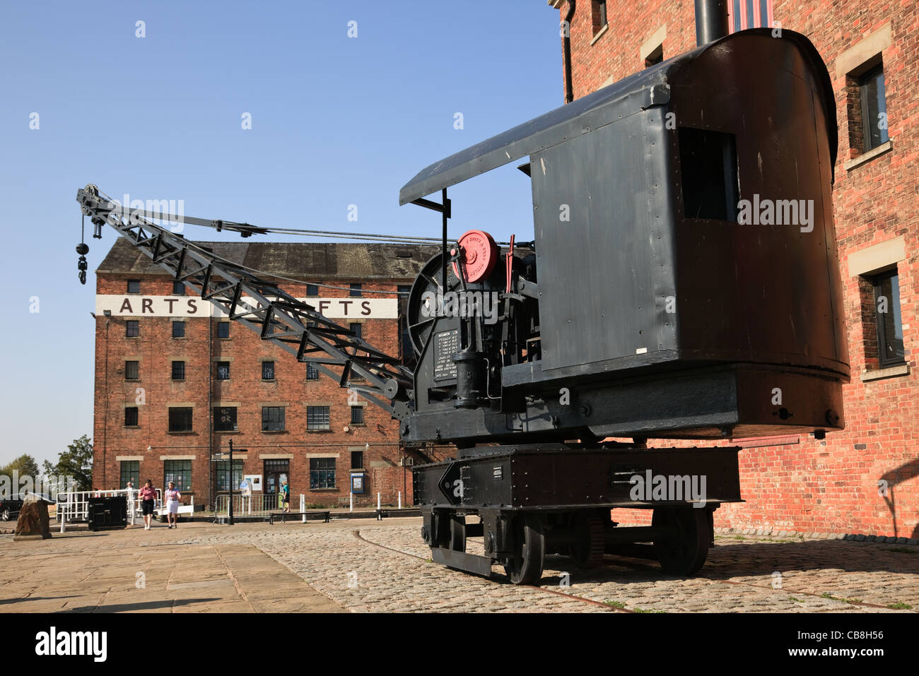 Old crane on the quay by Dock Basin. Gloucester Docks, Gloucester, Gloucestershire, England, UK Stock Photo