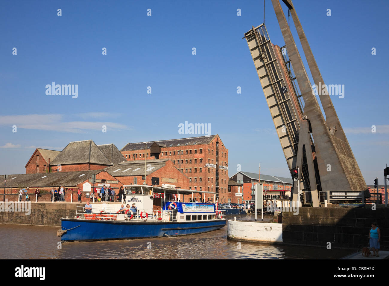 Queen Boadicea II boat passing under raised Llanthony lift bridge on Gloucester and Sharpness canal Gloucester Docks - Stock Image