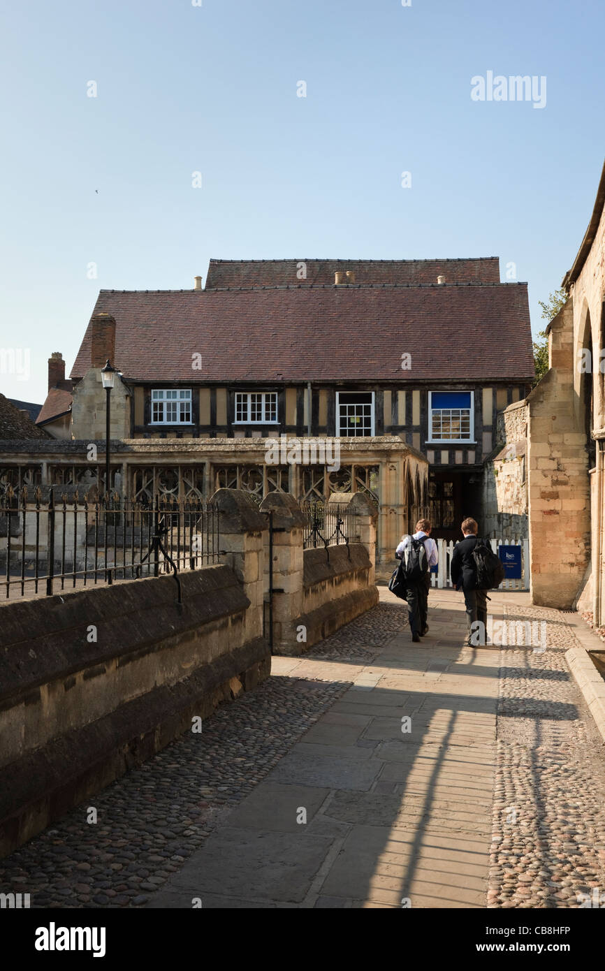 Gloucester Gloucestershire England UK. Pupils entering The King's School Little Cloister House in Cathedral - Stock Image