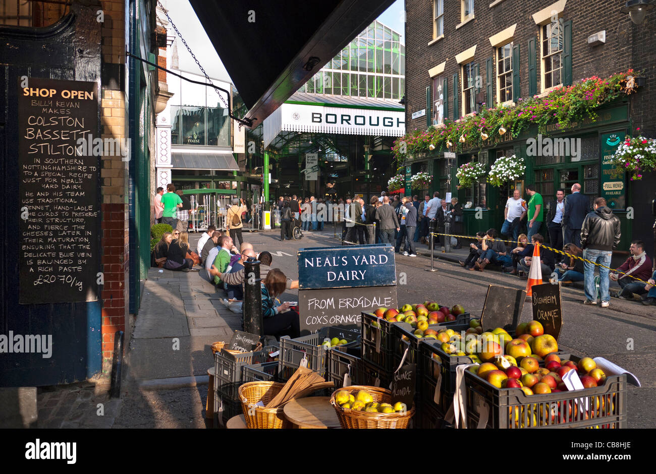 Borough Market a renowned popular international produce retail market and Neal's Yard Dairy London Bridge Southwark - Stock Image