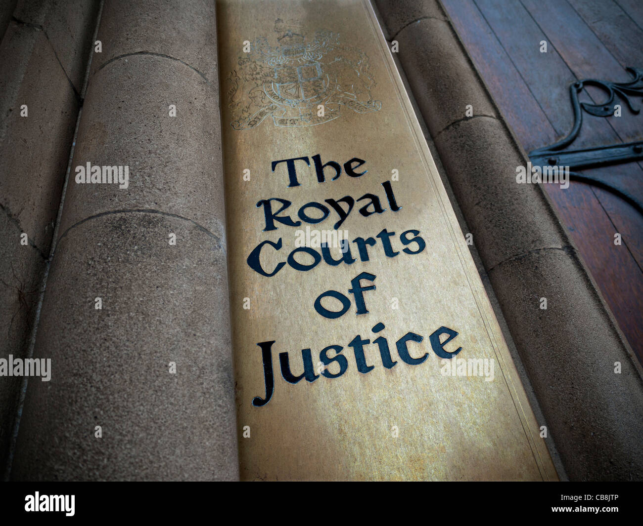 Entrance and sign to Royal Courts of Justice London UK - Stock Image