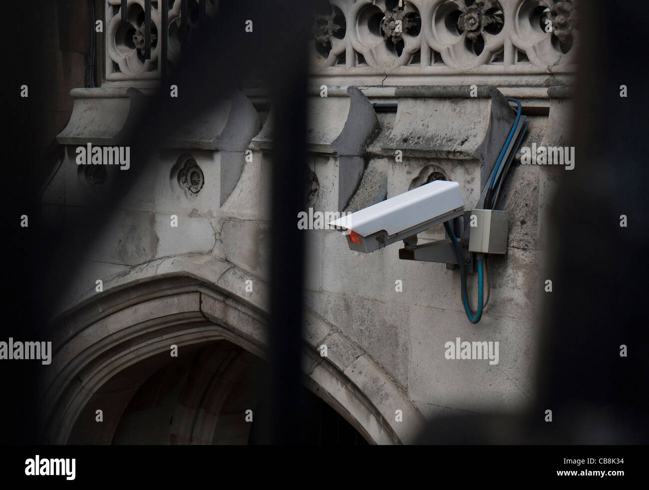 CCTV security camera attached to historic building in London - Stock Image