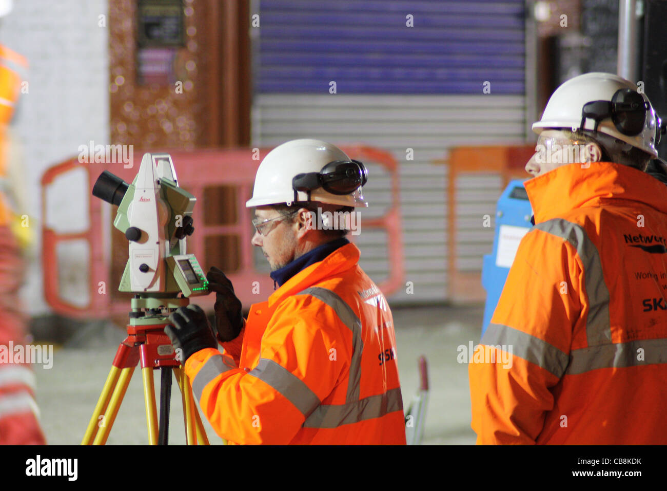 Surveyor using a theodolite - Stock Image