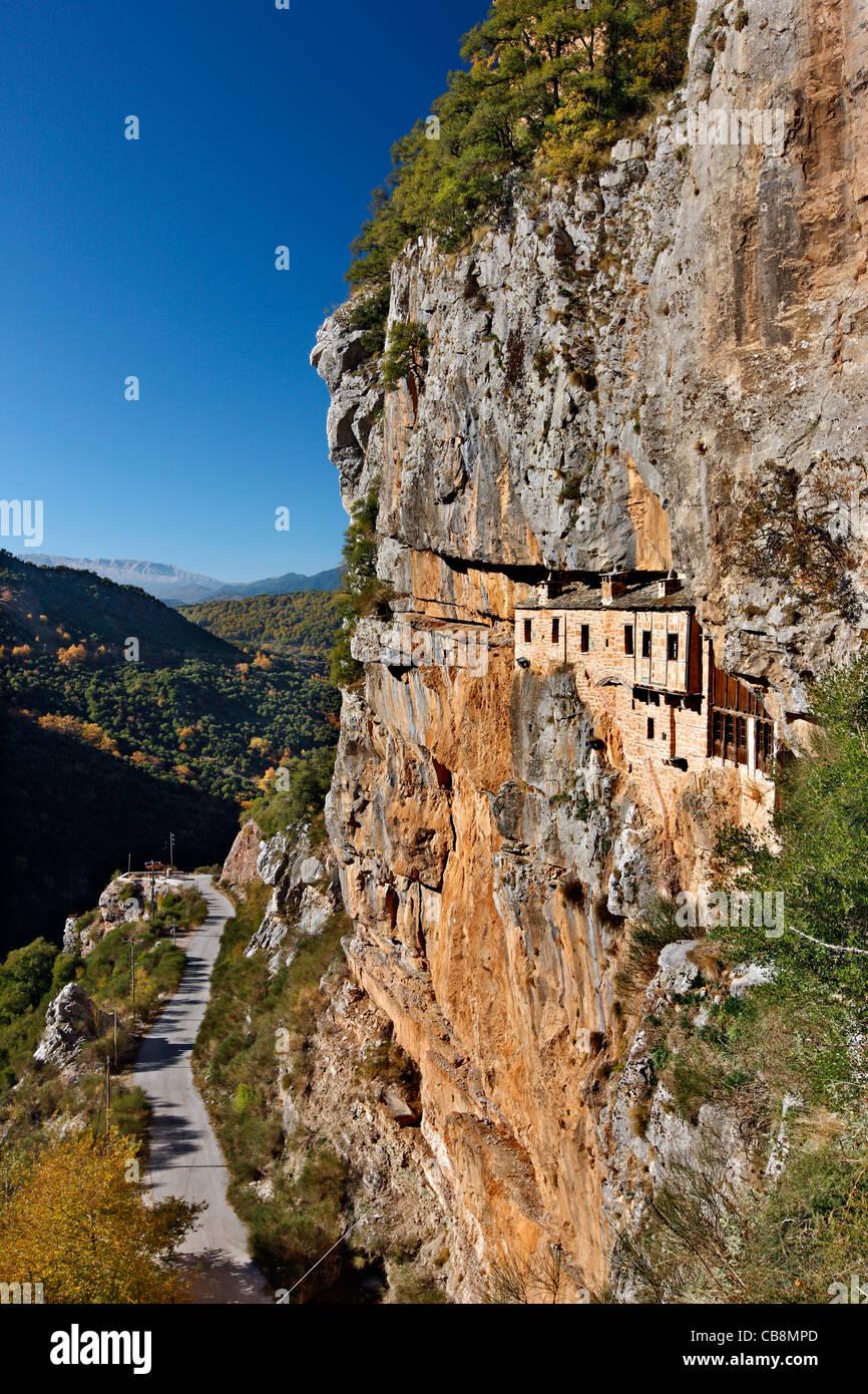 The holy monastery of Kipina, hanging from a cliff in Tzoumerka mountainous region, Ioannina, Epirus, Greece - Stock Image