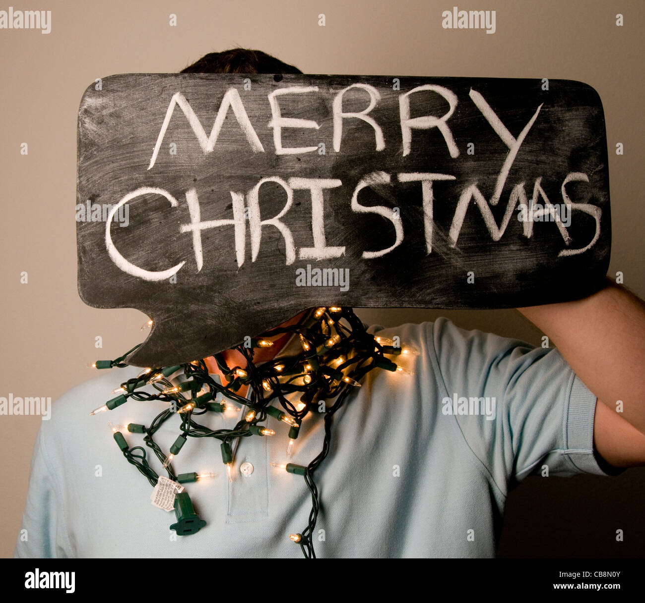 man holding merry christmas sign on chalkboard bubble stock image