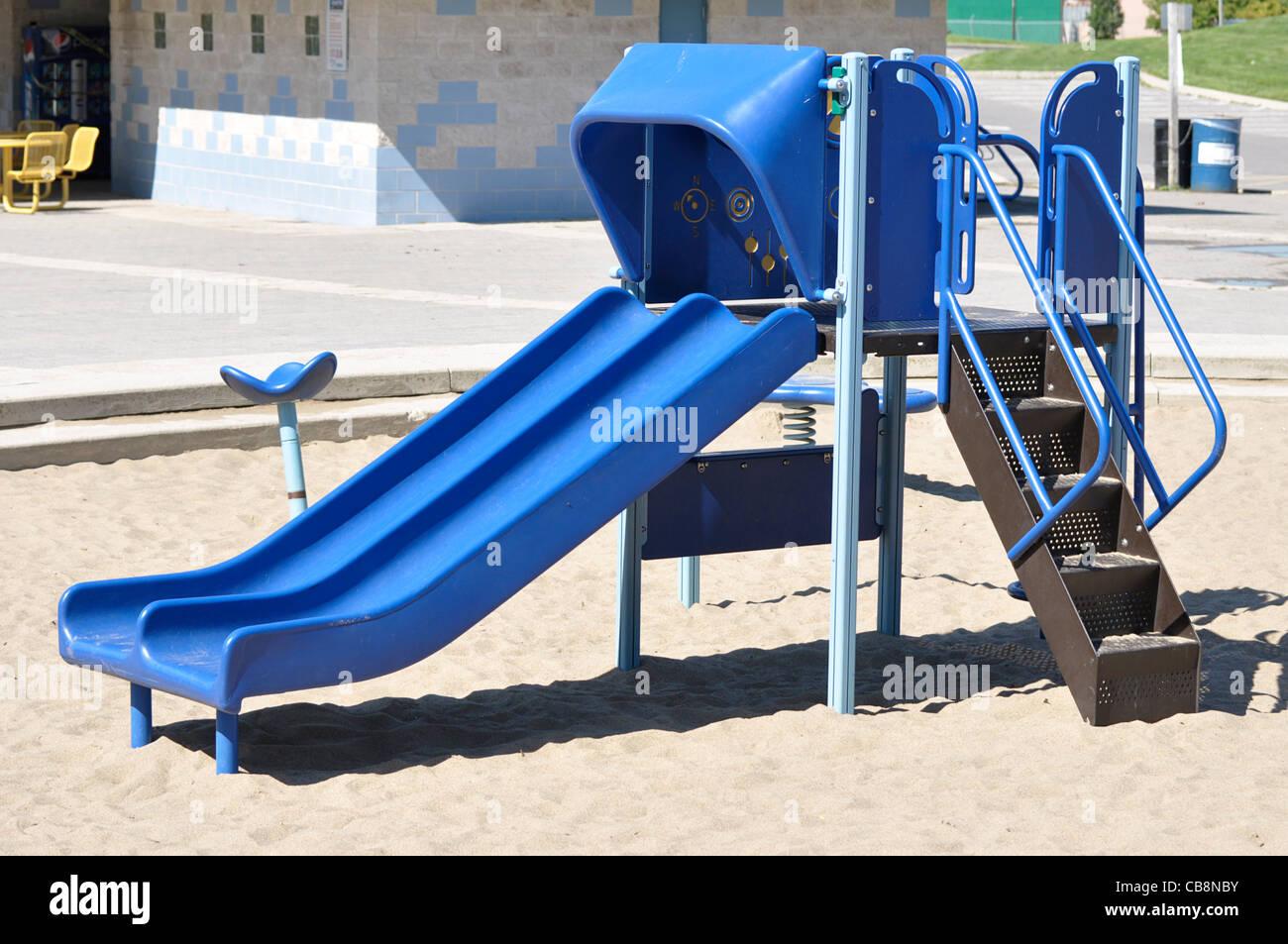 Slide in Children's Playground - Stock Image