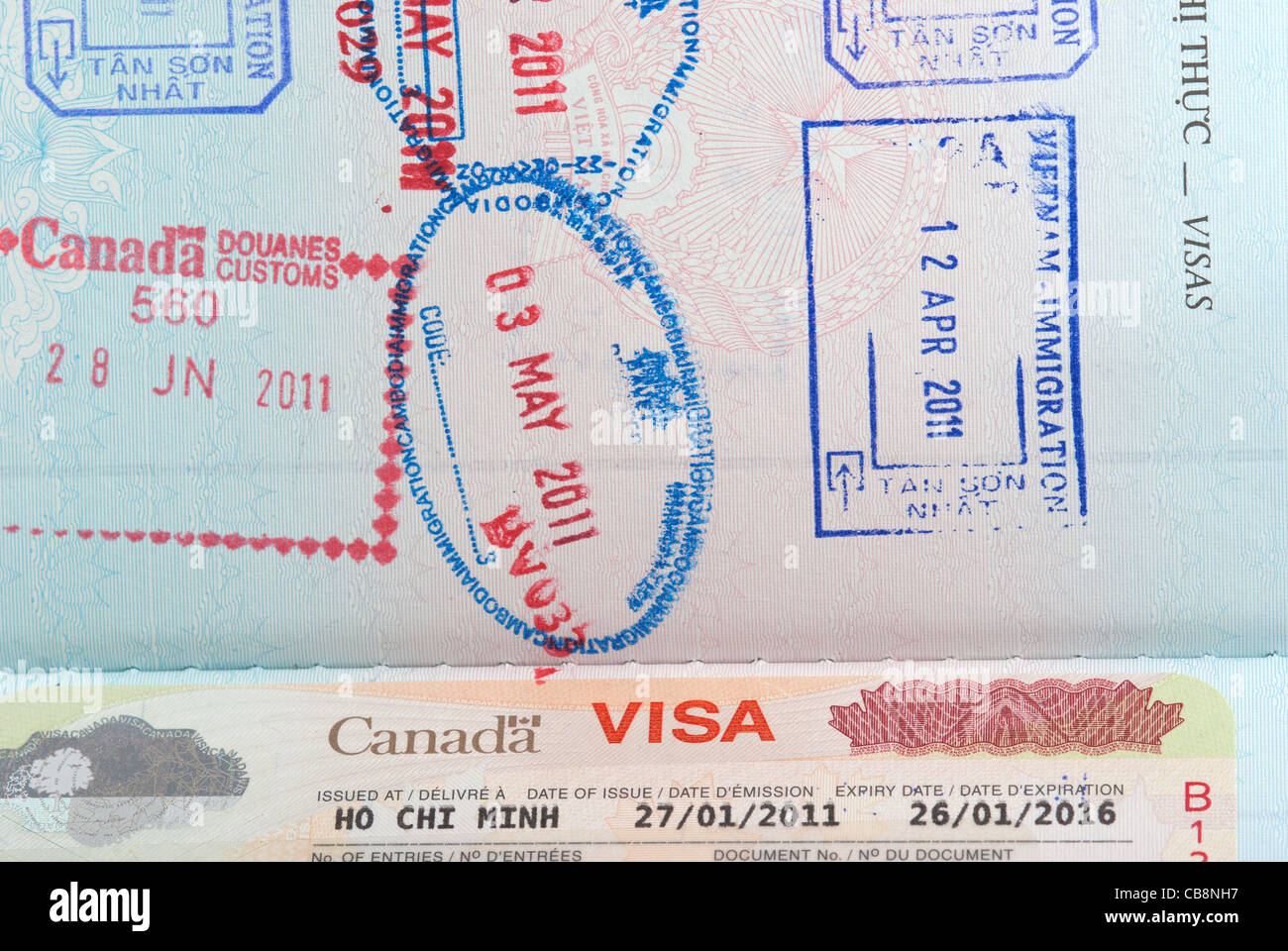 Canadian Visa Along With Passport Stamps In A Vietnamese