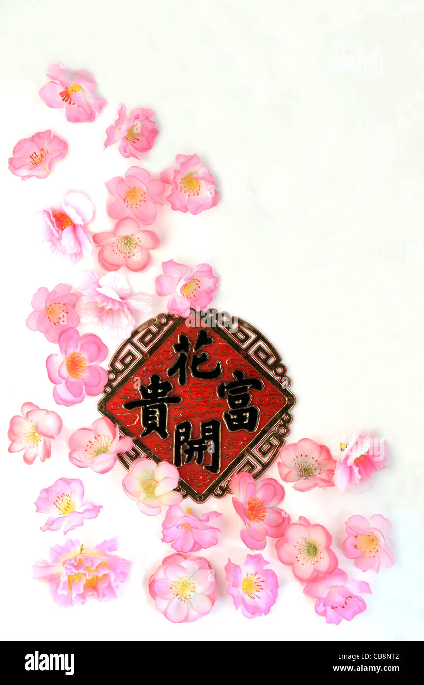 Chinese New Year ornament with Chinese characters stated flowers blooming with prosperity - Stock Image