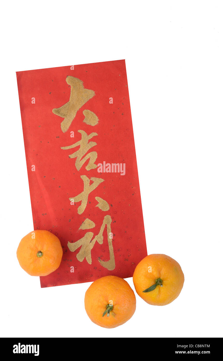 Chinese New Year auspicious calligraphy and tangerines - Stock Image