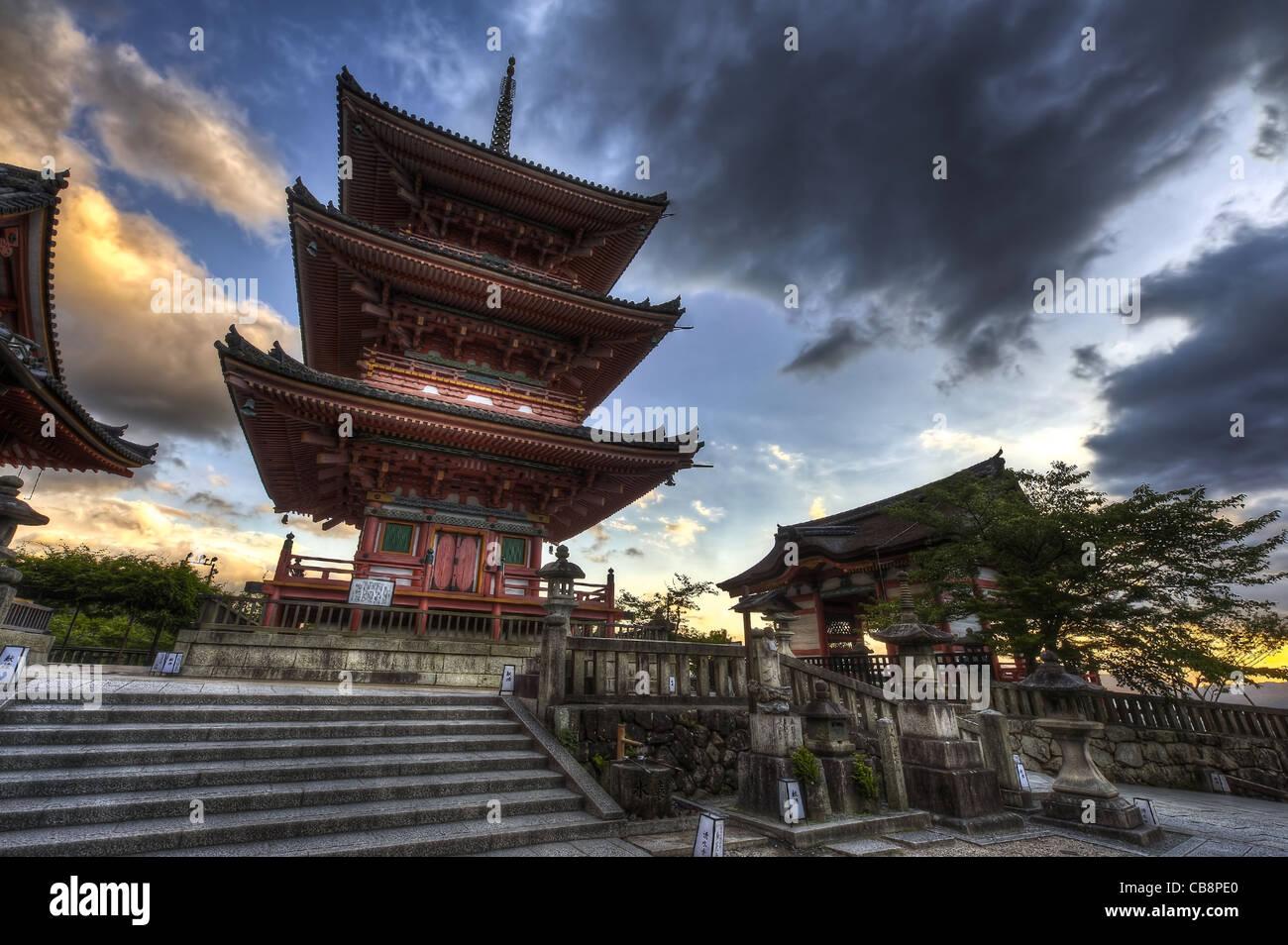 Three-story pagoda at famous Buddhism Kiyomizu-dera temple after the sunset. Kyoto, Japan. Built in Heian era. HDR - Stock Image