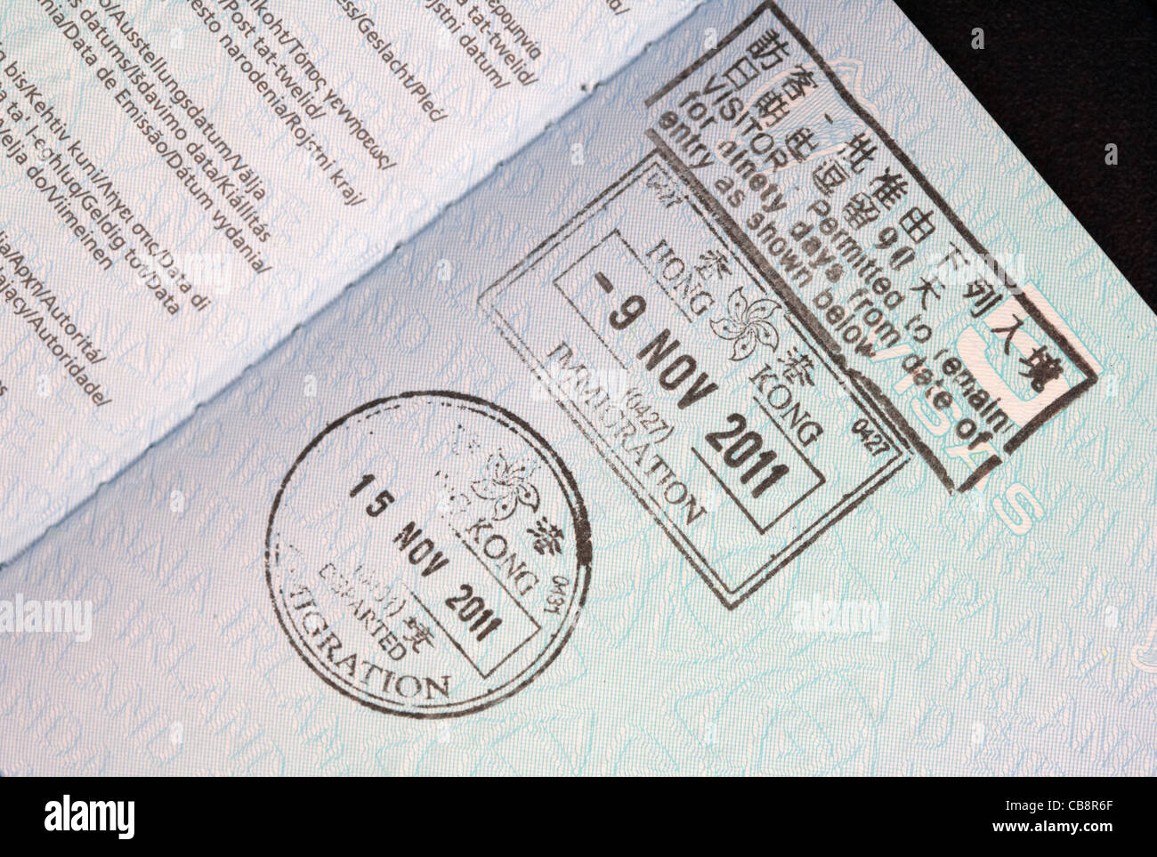 hong kong entry and exit visas stamp in an eu irish passport Stock Photo