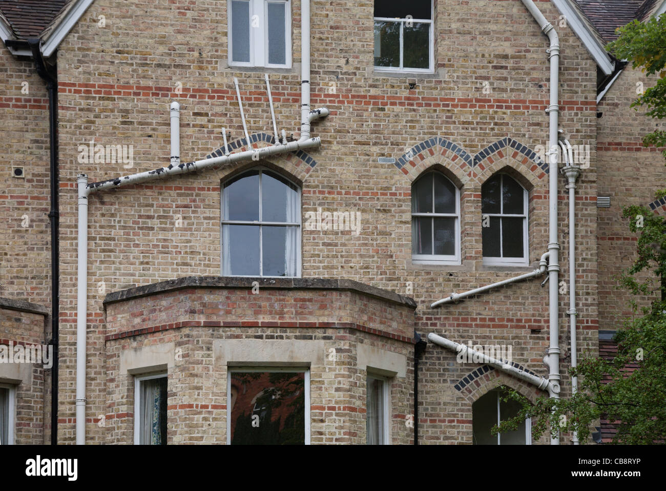 External plumbing in an old house, Oxford, UK - Stock Image