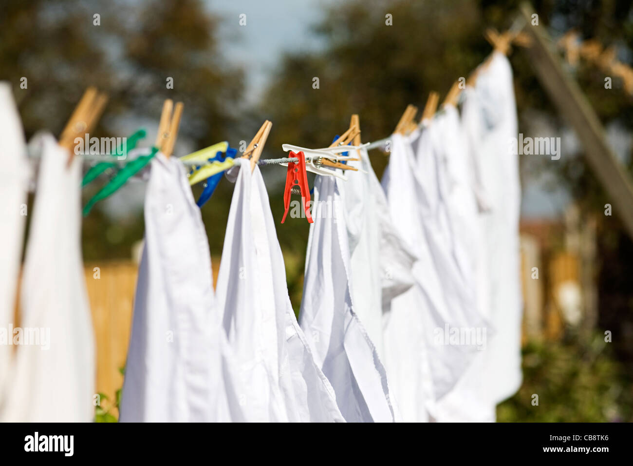 White Washing Pegged to Line Red Peg - Stock Image