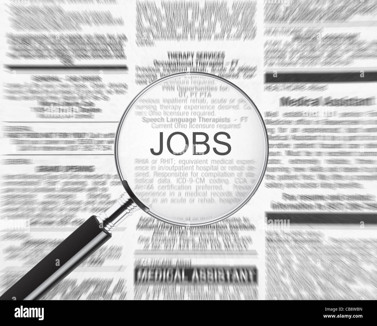 Jobs ad through a magnifying glass - Stock Image
