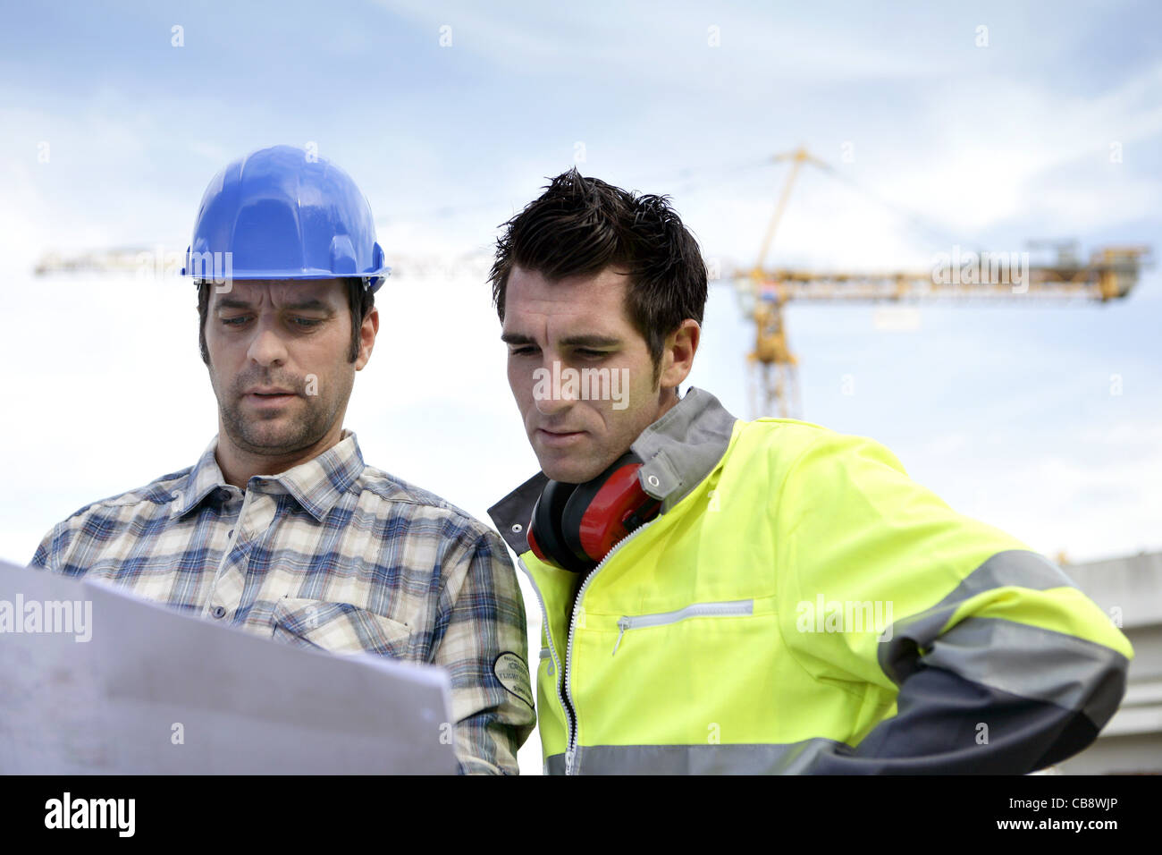 Two supervisors on a construction site looking at a blueprint stock two supervisors on a construction site looking at a blueprint malvernweather Image collections