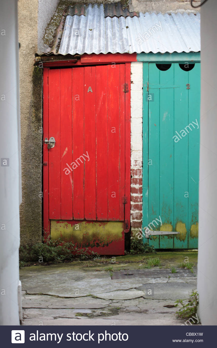 Very Brightly Coloured Outside Wooden Toilet Doors In An Alley At