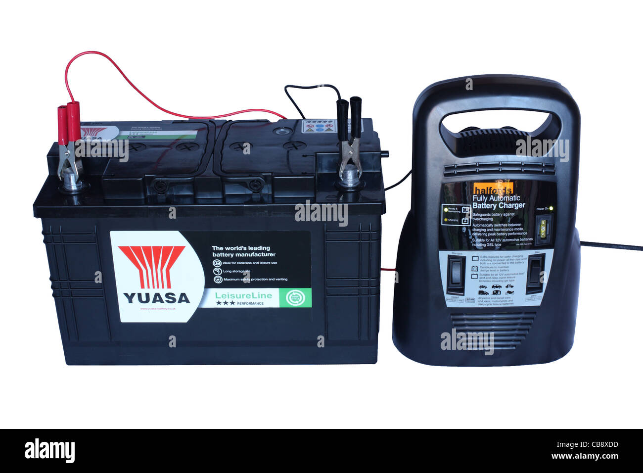 Charging a Yuasa lead acid leisure battery using an automatic deep cycle charger supplied by Halfords  isolated - Stock Image
