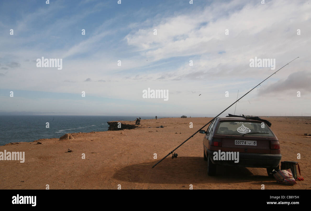 Cliff-fishing in the Western Sahara of Morocco - Stock Image