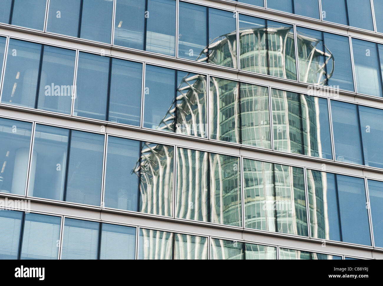 CityPoint - formally named Britannic Tower - reflected in the windows of an adjacent building. - Stock Image