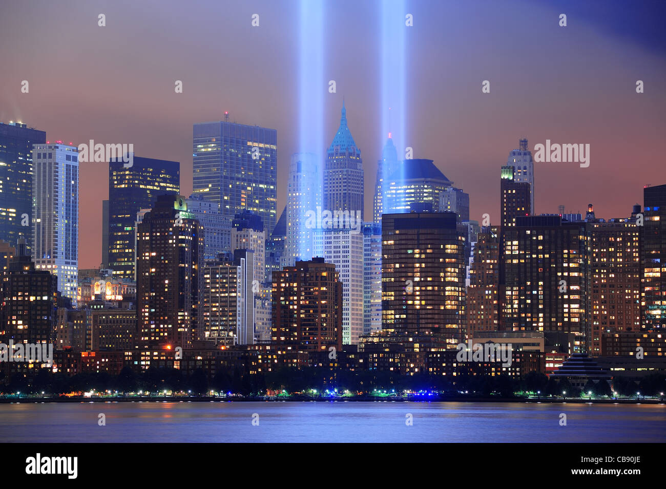New York City Manhattan Downtown Skyline At Night From Liberty Park With  Light Beams In Memory Of September 11