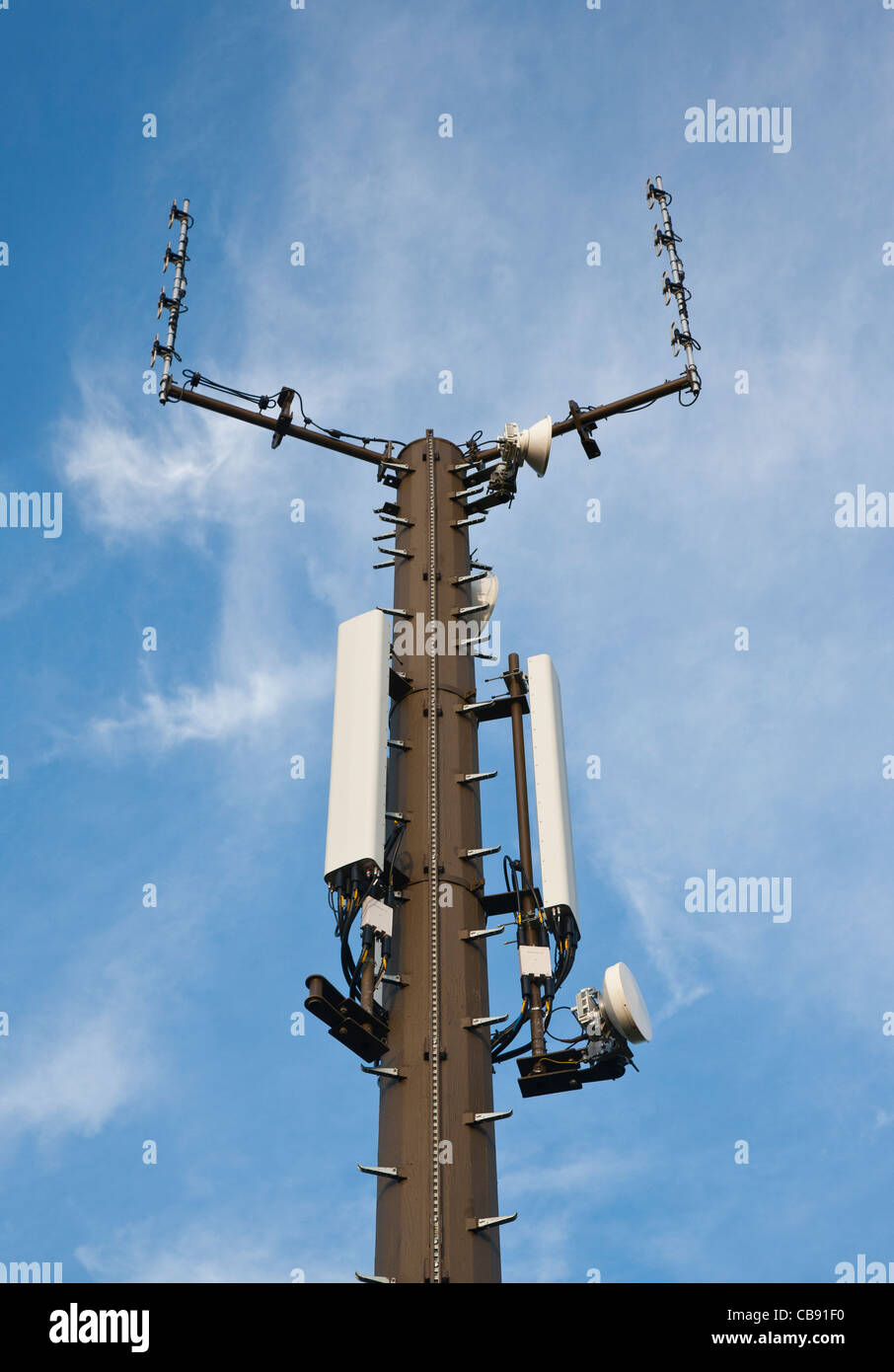 Mobile telecommunications and microwave masts near Crediton, Devon, England - Stock Image