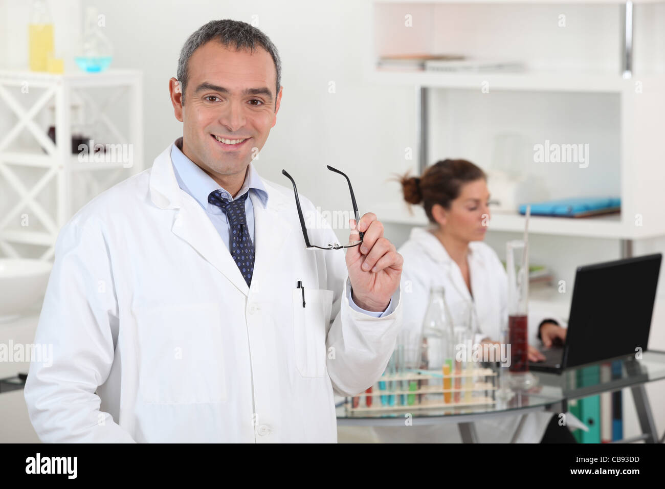A couple of scientists working in their laboratory. - Stock Image