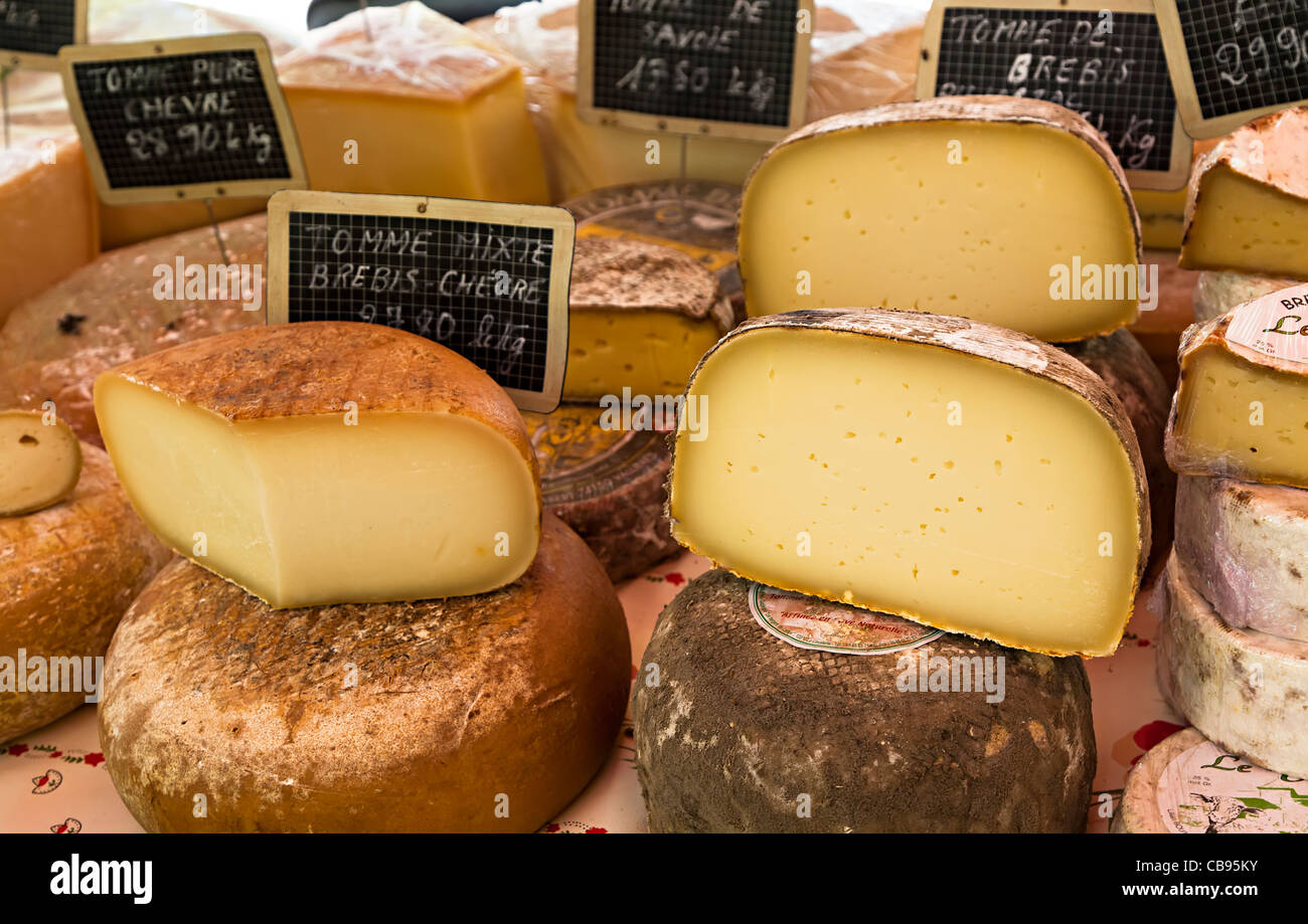 French cheeses on sale in market St Chinian France - Stock Image