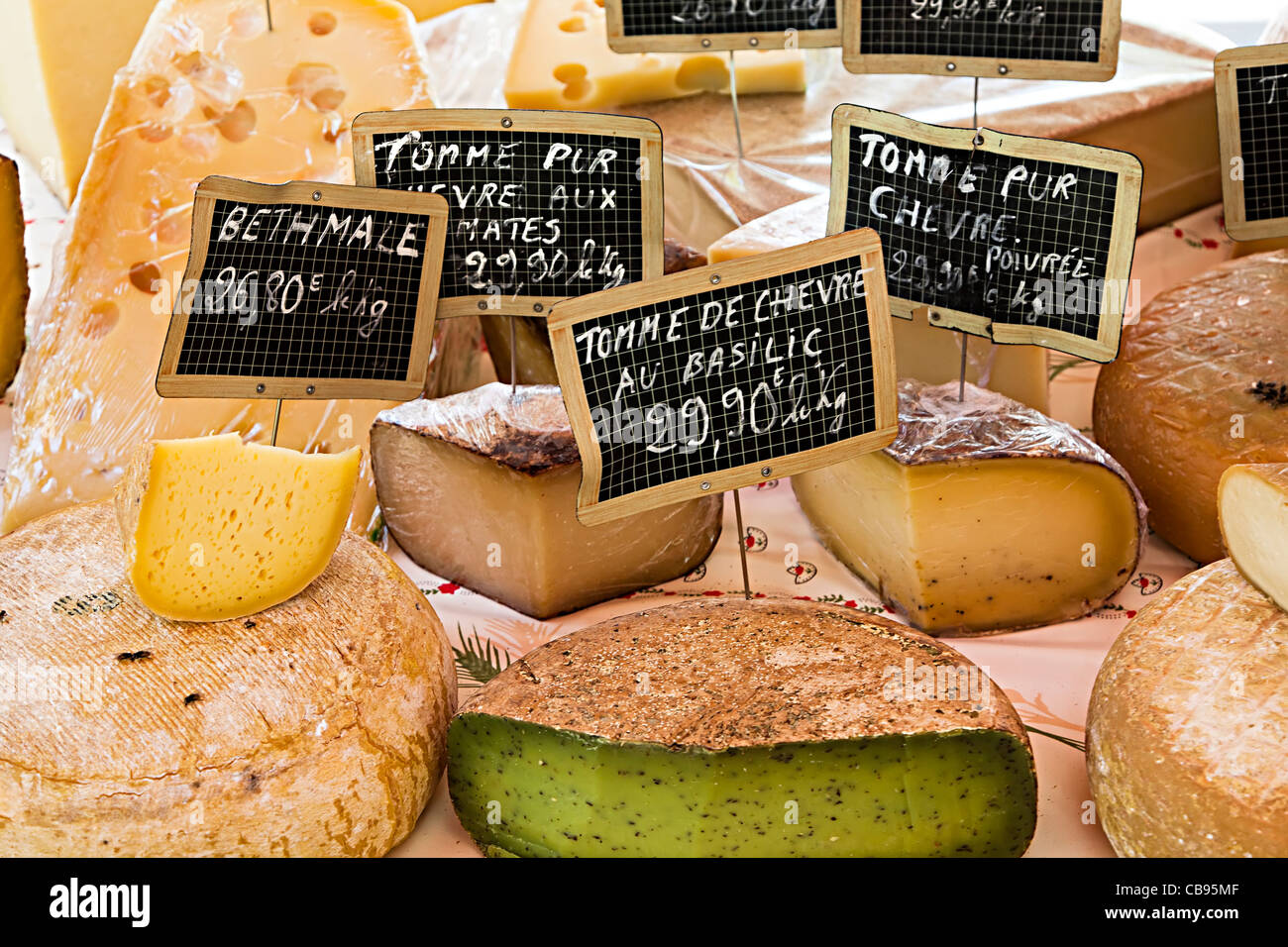 French cheeses including Tomme de Chevre on sale in market St Chinian France - Stock Image