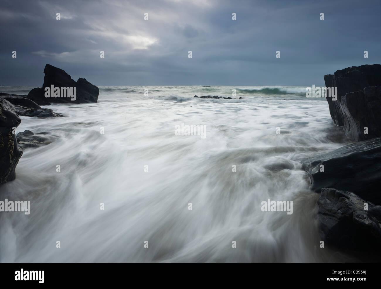 Waves crashing on a remote rugged coastline near County Mayo Ireland - Stock Image