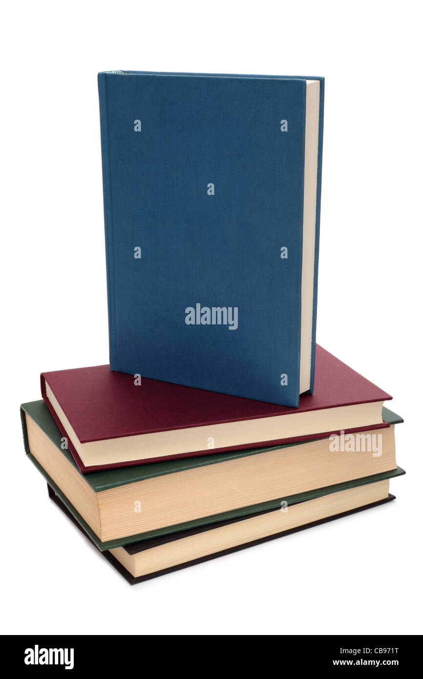 A stack of books with one book on the top showing a blank blue cover. - Stock Image