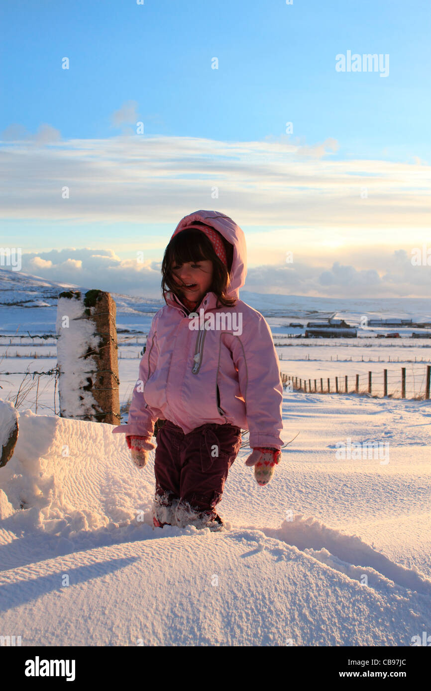 Young girl in snowdrift - Stock Image