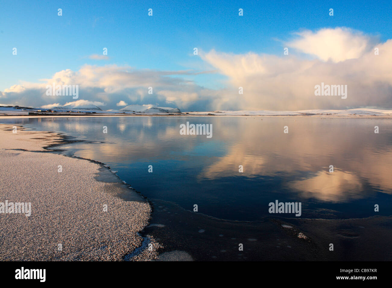Partially frozen Stenness Loch on Orkney - Stock Image
