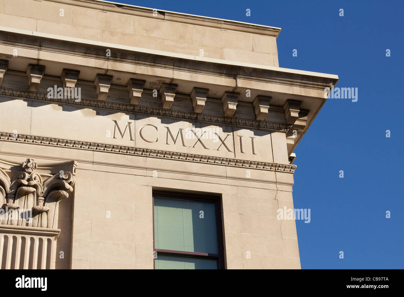 Building constructed in 1922 with Roman Numerals MCMXXII set in stone. - Stock Image