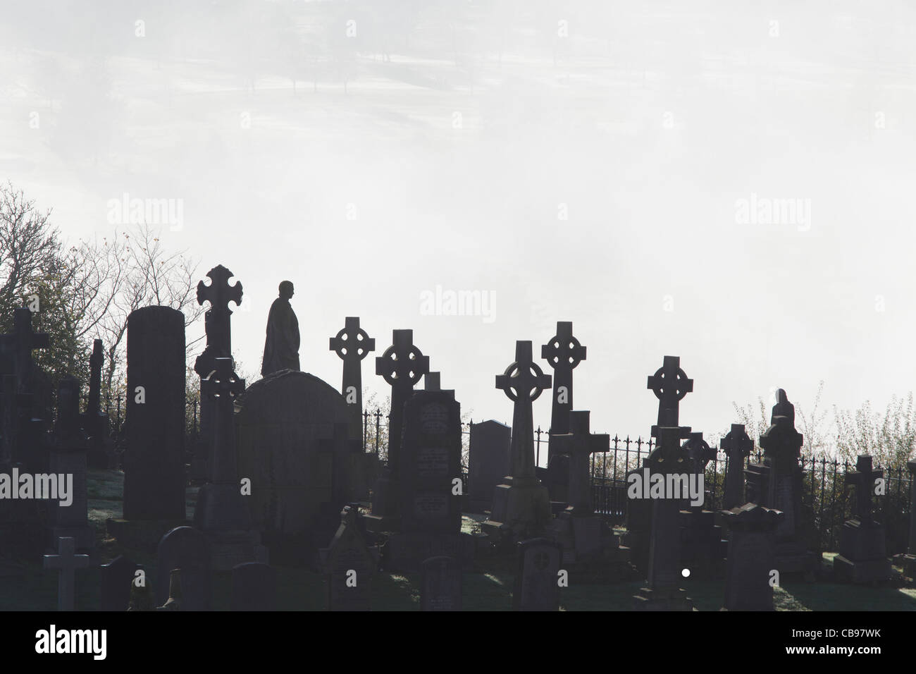Stirling Old Town Cemetery with fog in the background, Scotland, UK Stock Photo