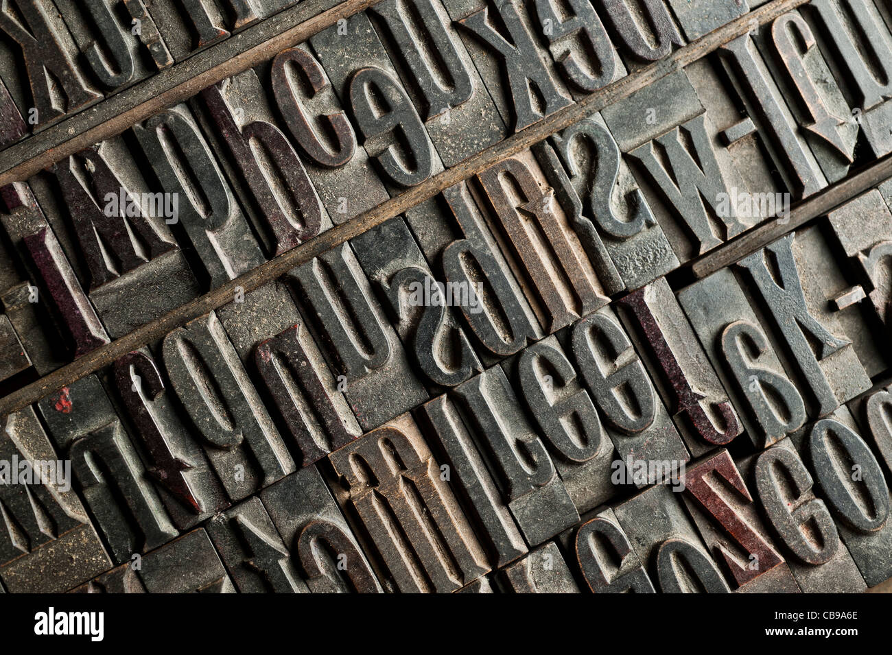 a tray of carved wooden letters, part of a letterpress set. - Stock Image