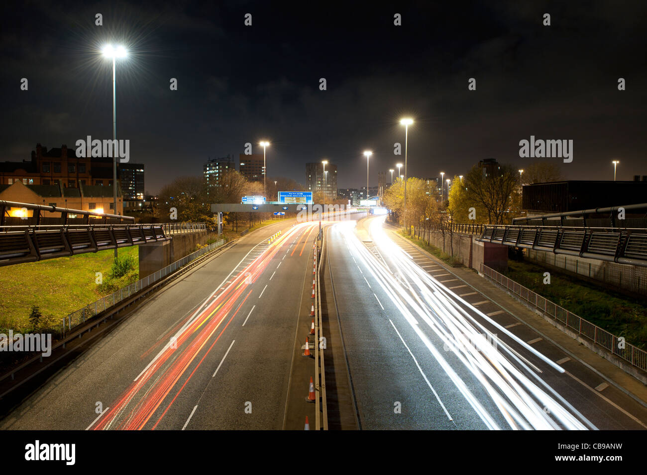 An evening shot of the A57(M) Manunian Way near to Hulme, Manchester. With long shutter light trails. - Stock Image