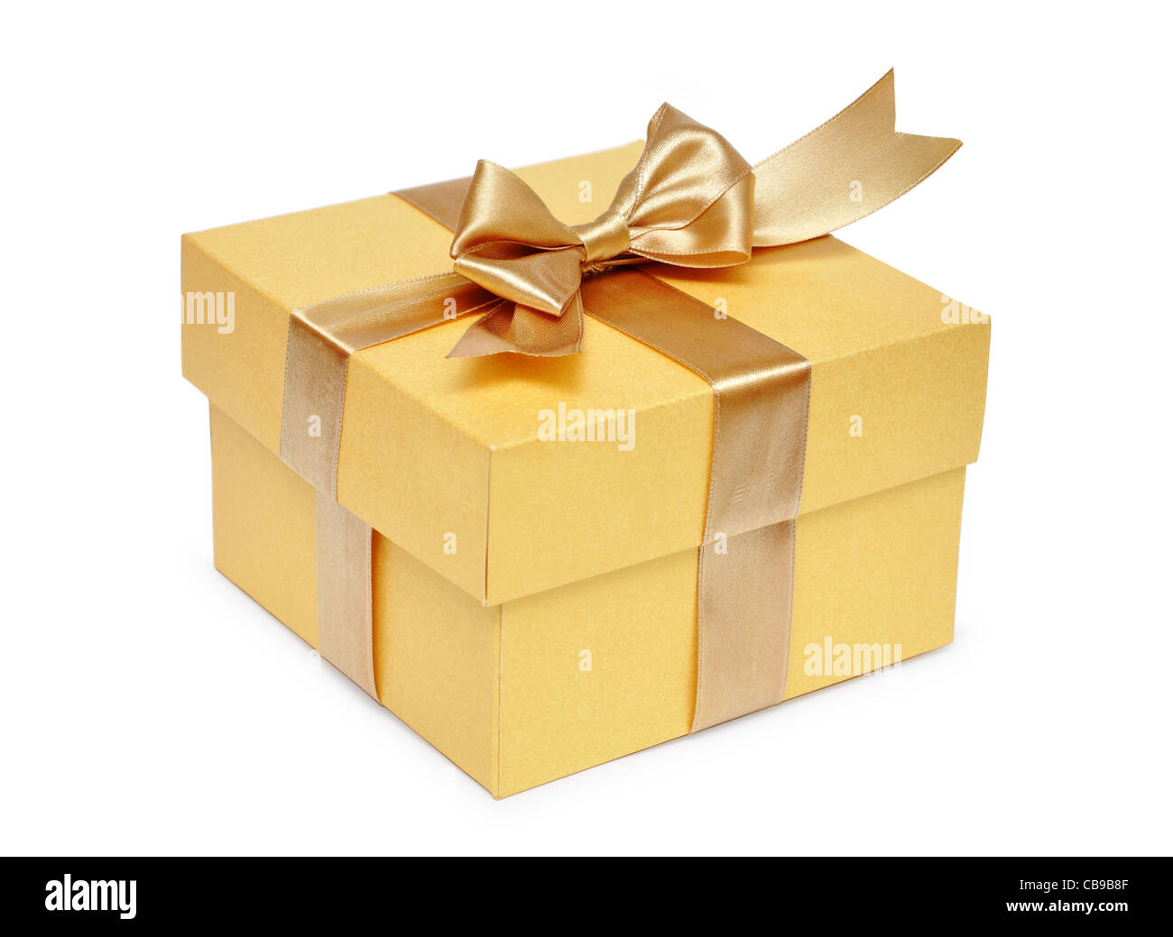 Golden gift box with golden ribbon over white background - Stock Image