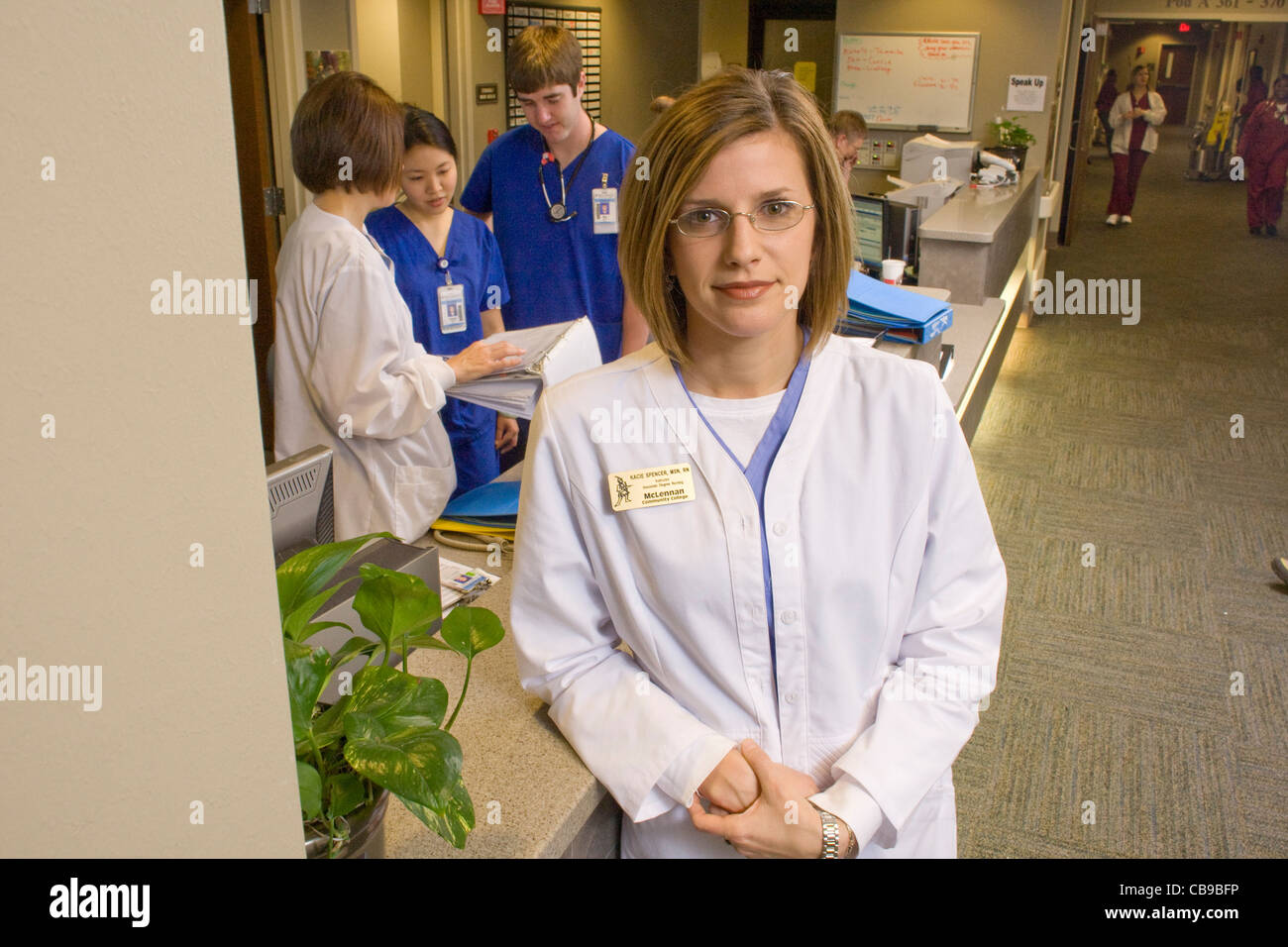 Waco, TX March 12, 2009: Nursing instructor Kacie Spencer, MSN, RN of McClennan Community College with some of her - Stock Image