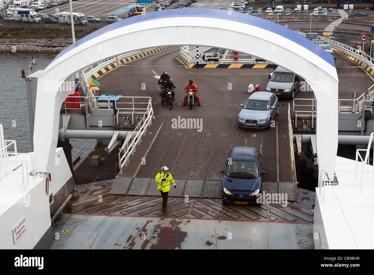 Cross channel ferry loading cars and motor cycles Dunkirk sailing for Dover France - Stock Image