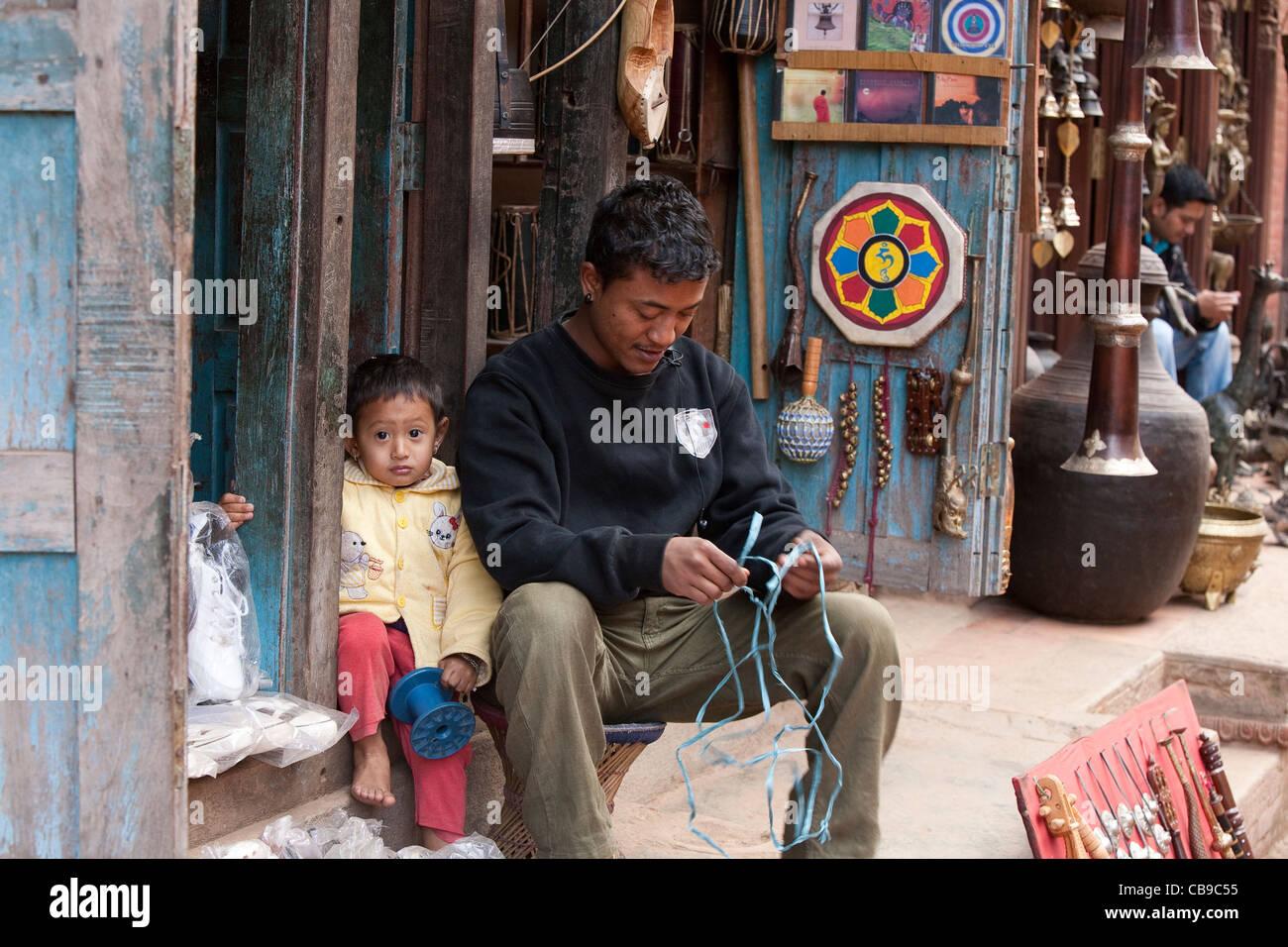 Shopkeeper near Taumadhi Tole - Bhaktapur, Kathmandu Valley, Nepal - Stock  Image