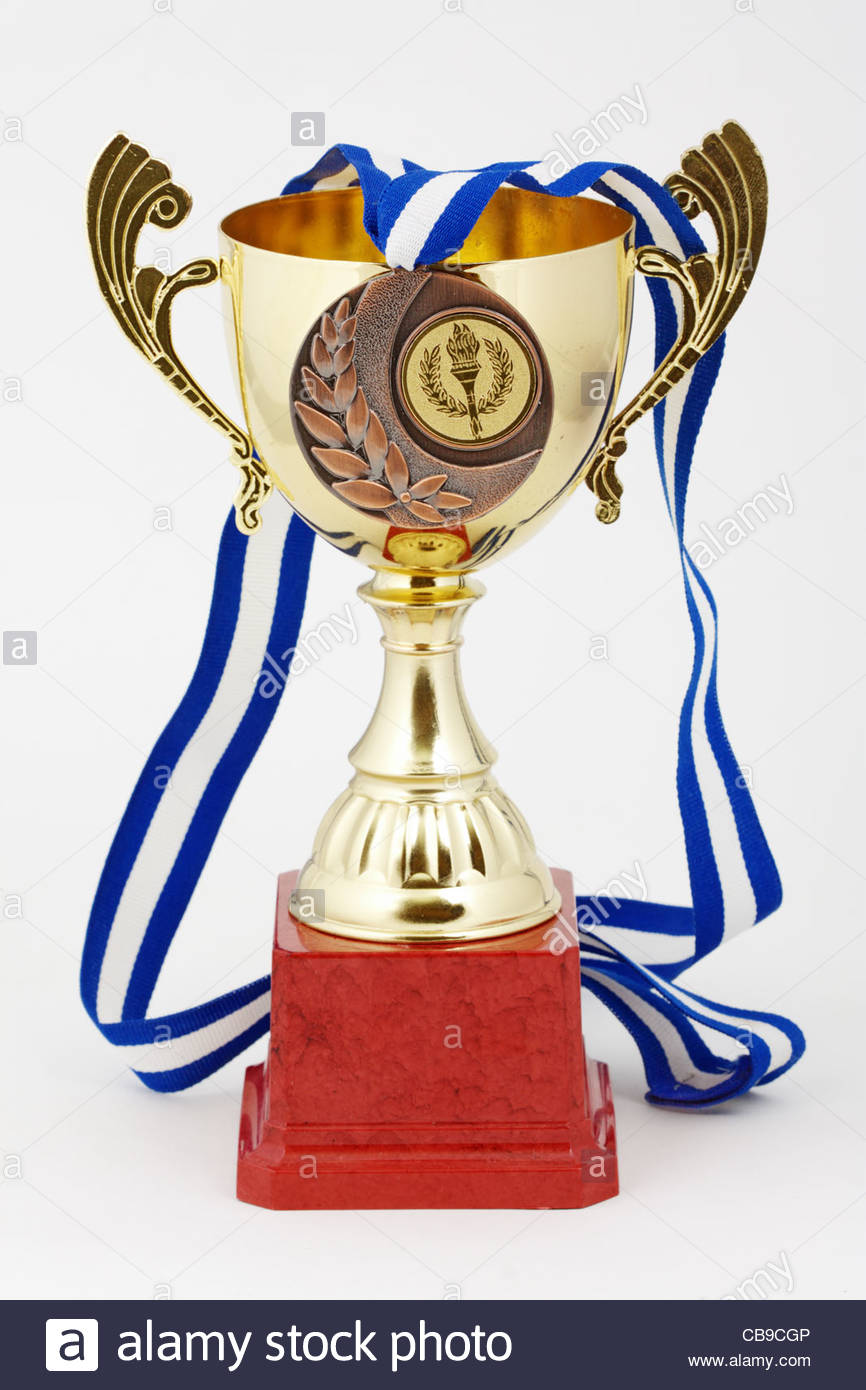 gold cup on white background with bronze medal - Stock Image